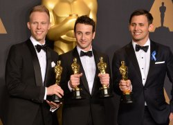 Justin Paul, Justin Hurwitz and Benj Pasek appear backstage with their Oscars at the 89th annual Academy Awards in Hollywood