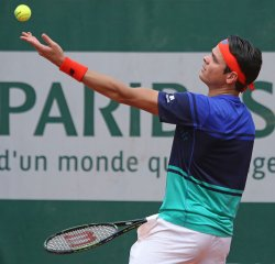 Milos Raonic of Canada serves at French Open