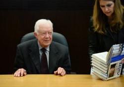 "Jimmy Carter signs copies of his new book ""A Call to Action: Women, Religion, Violence and Power"" in Los Angeles"
