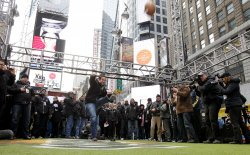 "Bill Gramatica kicks a field goal at the ""Tostitos Fiesta in the Square"" in New York"