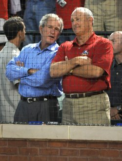 Former President George W. Bush talks with Nolan Ryan