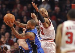 Magics Nelson grabs rebound from Bulls Gibson in Chicago