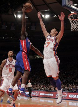 New York Knicks Jeremy Lin tries to block a shot from Detroit Pistons Ben Gordon at Madison Square Garden in New York