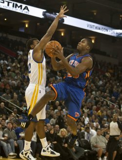 Knicks Toney Douglas drives in Oakland, California