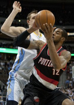 Blazers Aldridge Moves Against the Nuggets Mozgov in Denver