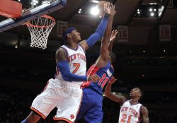 New York Knicks Carmelo Anthony blocks a shot from Detroit Pistons Tayshaun Prince at Madison Square Garden in New York