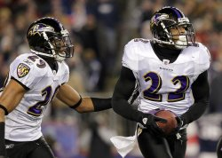 Baltimore Ravens Carey Williams runs with Jimmy Smith after Smith runs back an interception for 39 yards in the AFC Championship Game at Gillette Stadium in Massachusetts