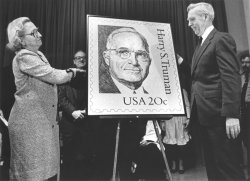 Margaret Truman and General Postmaster Willam Bolger unveil the Harry S. Truman stamp