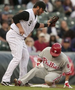 Phillies Victorino Triples Against the Rockies in Denver