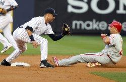 New York Yankees Derek Jeter tries to tag Philadelphia Phillies Greg Dobbs at Yankee Stadium in New York