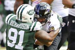 Ravens Joe Flacco is sacked by Jets Sheldon Richardson