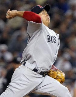 Boston Red Sox starting pitcher Daisuke Matsuzaka throws a pitch at Yankee Stadium in New York