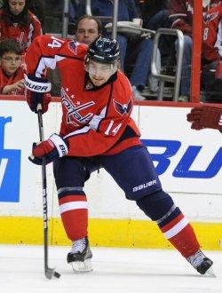 Capitals Fleischmann handles puck against Coyotes in Washington