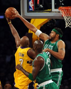 Lakers' Lamar Odom shoots over is fouled by Celtic's Rasheed Wallace during NBA game in Los Angeles