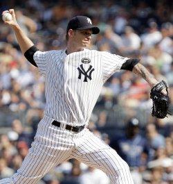 New York Yankees starting pitcher A.J. Burnett throws a pitch at Yankees Stadium in New York