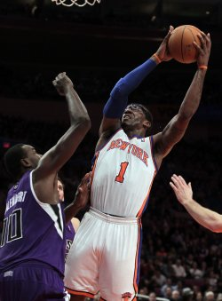Sacramento Kings Samuel Dalembert plays defense on New York Knicks Amar'e Stoudemire at Madison Square Garden in New York