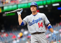 Dodgers Jamey Carroll throws his bat in Washington