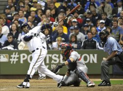 Brewers Yuniesky Betancourt connects for a RBI double during game 6 of NLCS in Milwaukee, Wisconsin