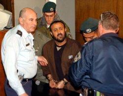 Israeli police surround Palestinian Tanzim leader Marwan Barghouti in Tel Aviv District Court