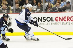 Jets Evander Kane Breaks Away from Pens Niskanen in Pittsburgh