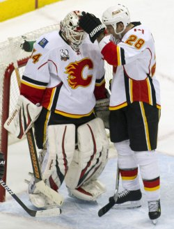 Flames Goalie Kiprusoff Congratulated by Regeher in Denver