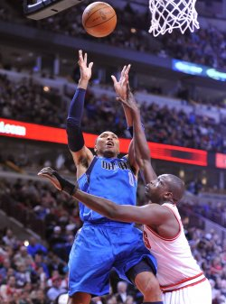 Mavericks' Marion shoots as Bulls' Deng defends in Chicago