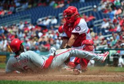 Nationals catcher Wilson Ramos tags out Phillies John Mayberry in Washington.