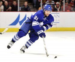 Maple Leafs Kessel Skates with Puck Against Blackhawks in Chicago