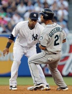 New York Yankees Robinson Cano tags out Seattle Mariners Franklin Gutierrez at Yankee Stadium in New York