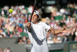 Tommy Haas returnsin his match against Novak Djokovic
