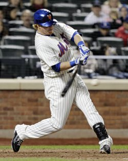 New York Mets Justin Turner drives in 2 runs with a single at Citi Field in New York