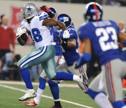 Cowboys Felix Jones rushes against the Giants in Texas