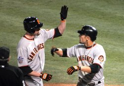 Giants Aubrey Huff homers against the Texas Rangers in the 3rd inning of game 4 of the World Series