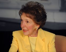 Nancy Reagan looks at photographs with GE Chairman Jeffrey Immelt in Simi Valley, California