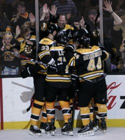 Bruins celebrate goal against Canucks in game 3 of Stanley Cup Finals in Boston, MA.