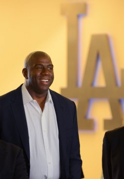 """Earvin """"Magic"""" Johnson participates in a news conference to announce Dodgers blockbuster trade in Los Angeles"""