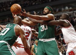 Celtics' Wallace and Bulls' Deng go for rebound in Chicago