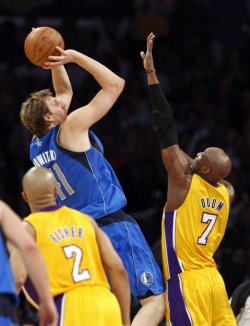 Dallas Maverick's forward Dirk Nowitzki shoots over Los Angeles Lakers' Lamar Odom in the second half of Game 2 of the Western Conference semifinals