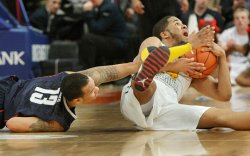 UConn defeats West Virginia in second-round action at the NCAA Big East Men's Basketball Championships in New York