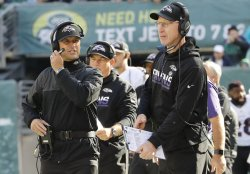 Ravens coach John Harbaugh stands on the sidelines