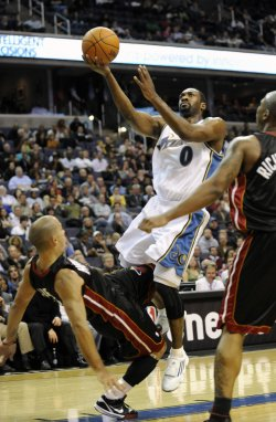 Arenas Scores and is Fouled by Arroyo of the Heat in Washington
