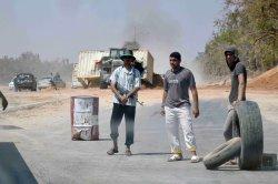 Libyan Rebels Search for Moammar Gaddafi After taking Tripoli