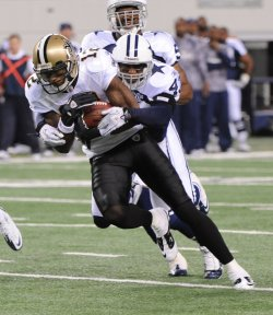 Saints Marques Colston gets wrapped up by Cowboys Gerald Sensabaugh during their