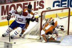 Flyers goalie Leighton pressured by Canadiens Plekanec in Philadelphia