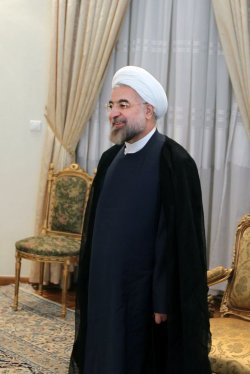 Iranian president Hassan Rouhani greets UN-Arab League Special Envoy to Syria Lakhdar Brahimi in Tehran
