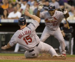 Cardinals Holliday Scores Against Rockies in Denver