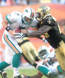 Chad Henne is sacked by New Orleans Saints at Miami Dolphins. NFL divisional game at Landshark Stadium in Miami.