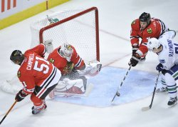 Blackhawks Hjalmarsson blocks Canucks Raymond's shtot in Chicago