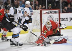 Blackhawks Crawford makes save against San Jose Sharks in Chicago