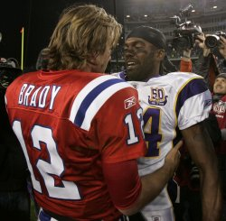 Vikings Moss hugs Patriots Brady at Gillette Stadium in Foxboro, MA.